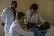 Medical staff check on Christine Mukanzayirambaho, 16, during the pre-operation period at King Faisal Hospital in Rwanda. Ms. Mukanzayirambaho needed her heart's mitral valve replaced.<br /> <br /> Rheumatic heart disease is damage to one or more heart valves that stems from inadequately treated strep throat. Left untreated, rheumatic heart disease leads to heart failure.