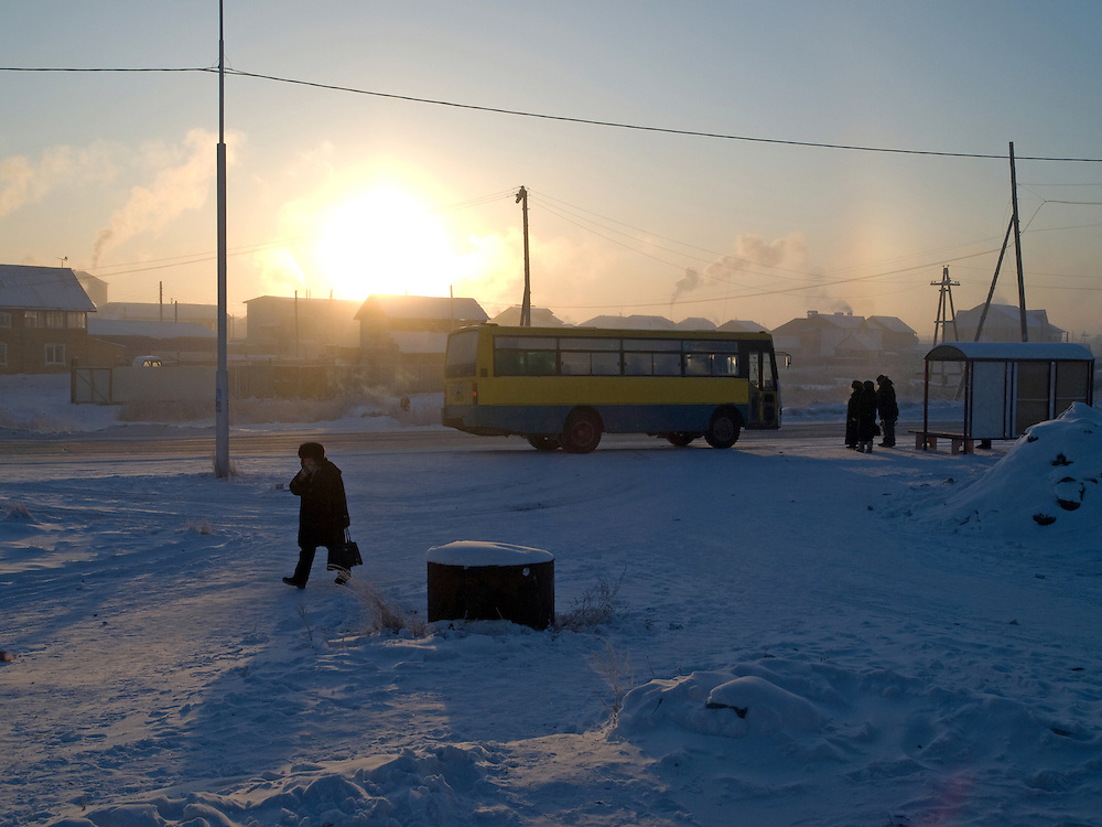 Bus stop during sunrise at the periphery of Yakutsk. Yakutsk is a city in the Russian Far East, located about 4 degrees (450 km) below the Arctic Circle. It is the capital of the Sakha (Yakutia) Republic (formerly the Yakut Autonomous Soviet Socialist Republic), Russia and a major port on the Lena River. Yakutsk is one of the coldest cities on earth, with winter temperatures averaging -40.9 degrees Celsius.