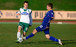 Erik Salkic of Olimpija vs Marko Pecnik of Drava at 18th Round of PrvaLiga football match between NK Olimpija and NK Labod Drava, on November 21, 2009, in ZAK, Ljubljana, Slovenia. Olimpija defeated Drava 3:0. (Photo by Vid Ponikvar / Sportida)