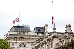 © Licensed to London News Pictures. 23/05/2017. London, UK. Union flags are half mast on Cabinet Office in Whitehall London on Tuesday 23 May 2017 following a terrorist attack that killed 22 and injured 59 people amongst children at Manchester Arena. Photo credit: Tolga Akmen/LNP