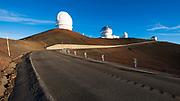 Observatories and road leading to the summit of Mauna Kea, The Big Island, Hawaii USA