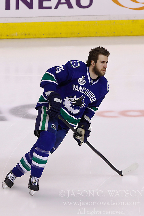 June 15, 2011; Vancouver, BC, CANADA; Vancouver Canucks left wing Tanner Glass (15) warms up before game seven of the 2011 Stanley Cup Finals against the Boston Bruins at Rogers Arena. Boston defeated Vancouver 4-0. Mandatory Credit: Jason O. Watson / US PRESSWIRE