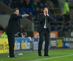CARDIFF, WALES - Tuesday, February 14, 2012: Cardiff City's manager Malky Mackay and Peterborough United's manager Darren Ferguson during the Football League Championship match at the Cardiff City Stadium. (Pic by David Rawcliffe/Propaganda)