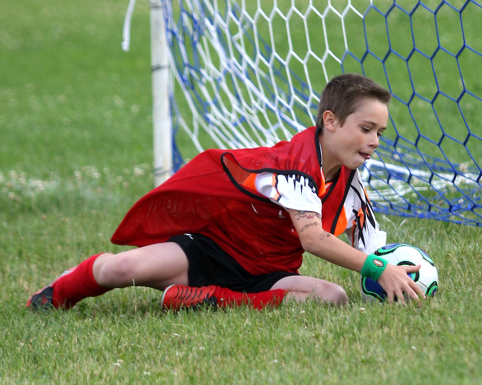 Goalie Nate Barone playing for Vavala Concrete makes a save during Southwestern Youth Soccer 6-2-09 photo by Mark L. Anderson