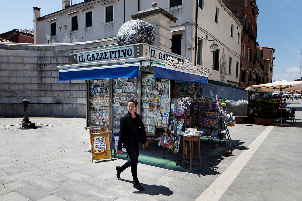 VENICE, ITALY - 27 MAY 2013: Contemporary artist Sarah Sze, 44, walks by her installation Triple Point (Compass), Il Gazzettino via Garibaldi, 2013 - photograph of rock printed on Tyvek, aluminum, plastic, and mixed media, in Venice, Italy, on May 27th 20113.<br /> <br /> Sarah Sze, 44, is a contemporary artist living and working in New York City. She is the U.S. representative for the Venice Biennale. the 55th International Art Exhibition in 2013.<br /> <br /> The 55th International Art Exhibition of the Venice Biennale takes place in Venice from June 1st to November 24th, 2013 at the Giardini and at the Arsenale as well as in various venues the city. <br /> <br /> Gianni Cipriano for The New York TImes
