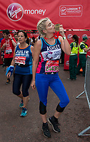 Ashley James (Made In Chelsea star and TV presenter running for Cancer Research UK) kisses her medal after finishing the race. The Virgin Money London Marathon, 23rd April 2017.<br /> <br /> Photo: Joanne Davidson for Virgin Money London Marathon<br /> <br /> For further information: media@londonmarathonevents.co.uk