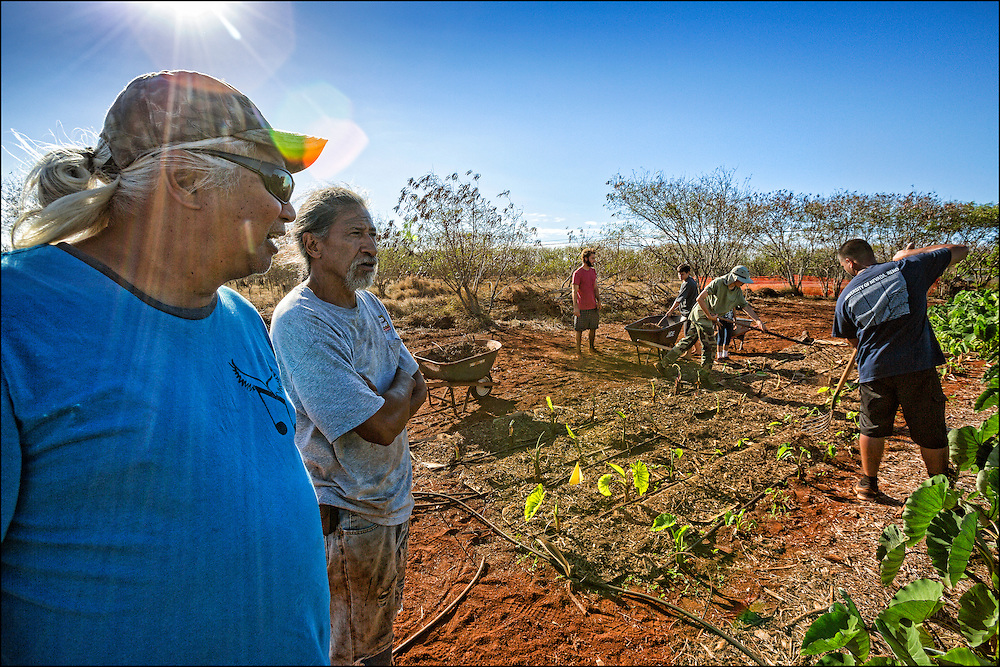 Brother Nolan and homestead farmer Bobby Alcain at his 'Aina Pulapula Farm on Molokai.