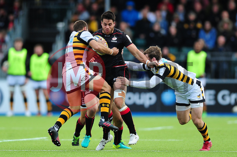 Sean Maitland of Saracens takes on the Wasps defence - Mandatory byline: Patrick Khachfe/JMP - 07966 386802 - 09/10/2016 - RUGBY UNION - Allianz Park - London, England - Saracens v Wasps - Aviva Premiership.
