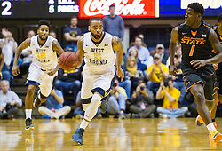 Jan 9, 2016; Morgantown, WV, USA; West Virginia Mountaineers guard Jaysean Paige (5) dribbles up the floor during the first half against the Oklahoma State Cowboys at the WVU Coliseum. Mandatory Credit: Ben Queen-USA TODAY Sports