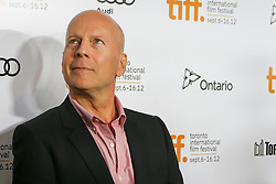 Actor BRUCE WILLIS at the 'Looper' opening night gala premiere at Roy Thompson Hall during the opening night of the 2012 Toronto International Film Festival, Thursday September 6, 2012. Photo By Christopher Drost/i-Images