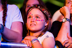 © Licensed to London News Pictures. 20/07/2014. Southwold, UK.  Young female fans of George Ezra watch him perform on stage at  Latitude Festival 2014 Day 3.   Latitude is an British annual music festival.  Photo credit : Richard Isaac/LNP