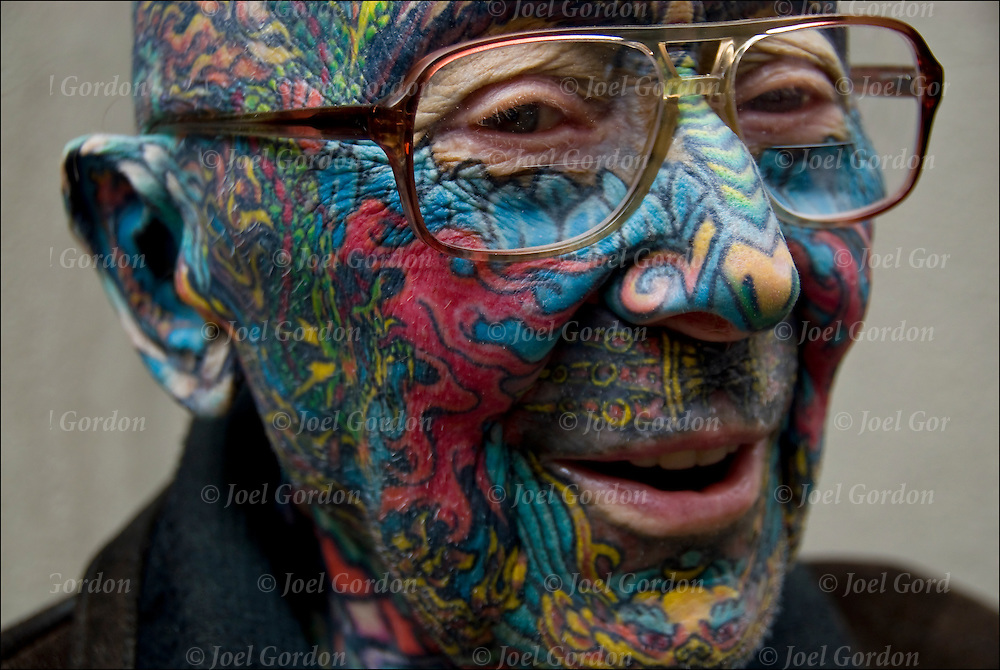 Senior in late sixties or early seventies with full body and face tattoos.<br /> <br /> Body art or tattoos has entered the mainstream it is known longer considered a weird kind of subculture.<br /> <br /> &quot;According to a 2006 Pew survey, 40% of Americans between the ages of 26 and 40 have been tattooed&quot;.