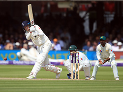 England's Joe Root hits four runs during day three of the First NatWest Test Series match at Lord's, London.