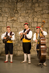 Europe, Croatia, Dalmatia, Dubrovnik.  Musicians in folk dance troup.