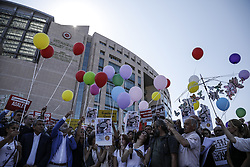 Activists release balloons as they gather outside the court in Istanbul, Turkey, Monday July 24, 2017, protesting against the trial of journalists and staff from the Cumhuriyet's newspaper, accused of aiding terror organizations. The newspaper staunchly opposed to President Recep Tayyip Erdogan has some of its staff go on trial - a case that has added to concerns over rights and freedoms in Turkey. Their arrests were part of a widespread crackdown in the wake of the coup, which has led to the imprisonment of more than 50,000 people. Photo by Can Erok/DHA/Depo Photos/ABACAPRESS.COM