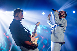 © Licensed to London News Pictures . 05/04/2014 . Manchester , UK . Nick Carter on guitar and A J McLean singing . The Backstreet Boys play at the Phones4U Arena in Manchester this evening (Saturday 5th April 2014) . Photo credit : Joel Goodman/LNP