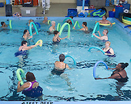 Middletown, New York - People enjoy an aquacize class in the pool at the Middletown YMCA  on Nov. 14, 2014.