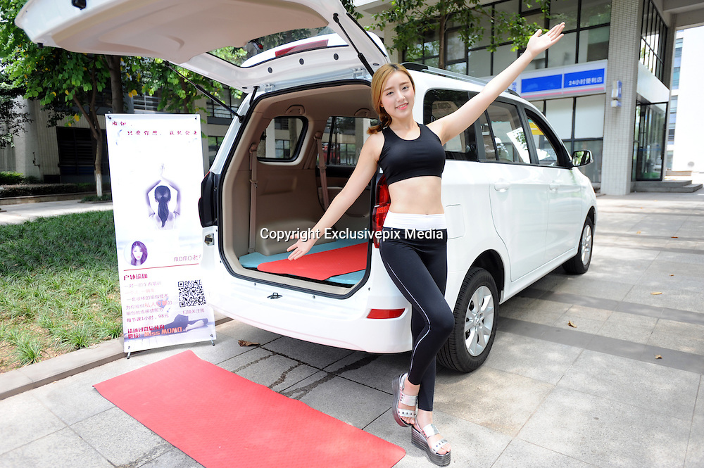 CHONGQING, CHINA - AUGUST 06: (CHINA OUT)<br /> <br /> Yoga Teaches from back of Car Boot <br /> <br />  Yoga teacher Momo takes part in a class with one student in her mobile classroom, a vehicle, <br /> ©Exclusivepix Media