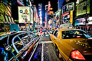 Risky picture between a cab and a limousine on 7th avenue in Times Square, Manhattan, New York, 2010.