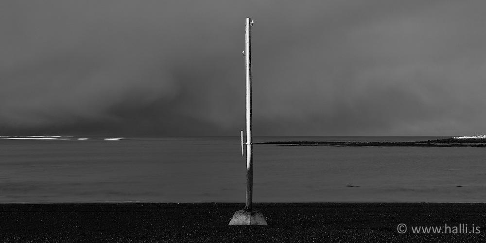 Old lamp post at the beach in Grotta, Reykjavik, Iceland - Staur í fjöru í Gróttu