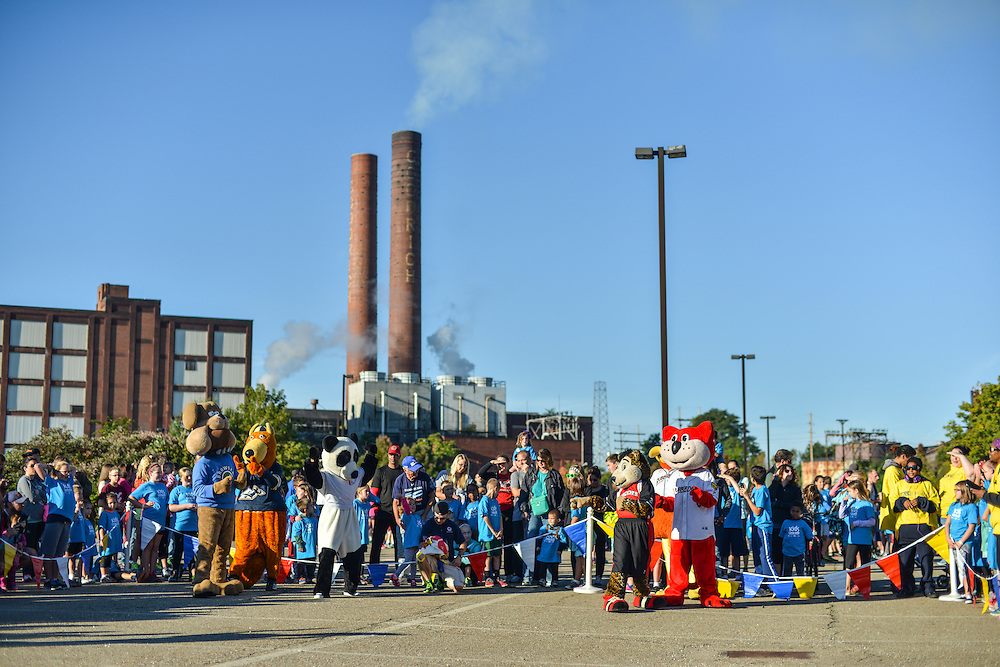 Akron mascots entertaining at the Kids Fun Run.