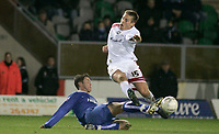 Photo: Marc Atkins.<br /> Milton Keynes Dons v Farsley Celtic. The FA Cup. 21/11/2006. Gareth Edds of MK Dons leaps to aviod the challenge of James Knwles of Farsley Celtic.