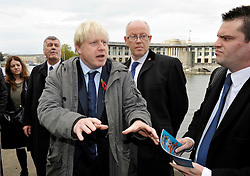 © Licensed to London News Pictures. 31/10/2012; Bristol, UK. Left-right: Ken Maddock, conservative candidate for police and crime commissioner for Avon & Somerset Police, Boris Johnson the Mayor of London, Geoff Gollop, conservative mayoral candidate for Bristol.  Boris Johnson reacts to protesters as the Mayor of London visits Bristol to support the Conservative candidates for the city's mayoral and police commissioner elections which take place on 15 November.  Boris was heckled by protesters on Bristol's dockside.  31 October 2012.  Photo credit: Simon Chapman/LNP
