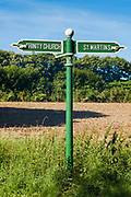 Signpost pointing to St Martins and Trinity Church in Jersey, Channel Isles