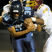 Hoggard's Keevin Thompson rushes against Lumberton's Ty Campbell Friday September 19, 2014. (Jason A. Frizzelle)