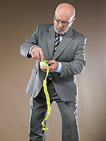 Businessman Peeling Apple