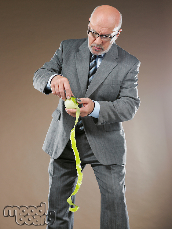 Businessman Peeling Apple