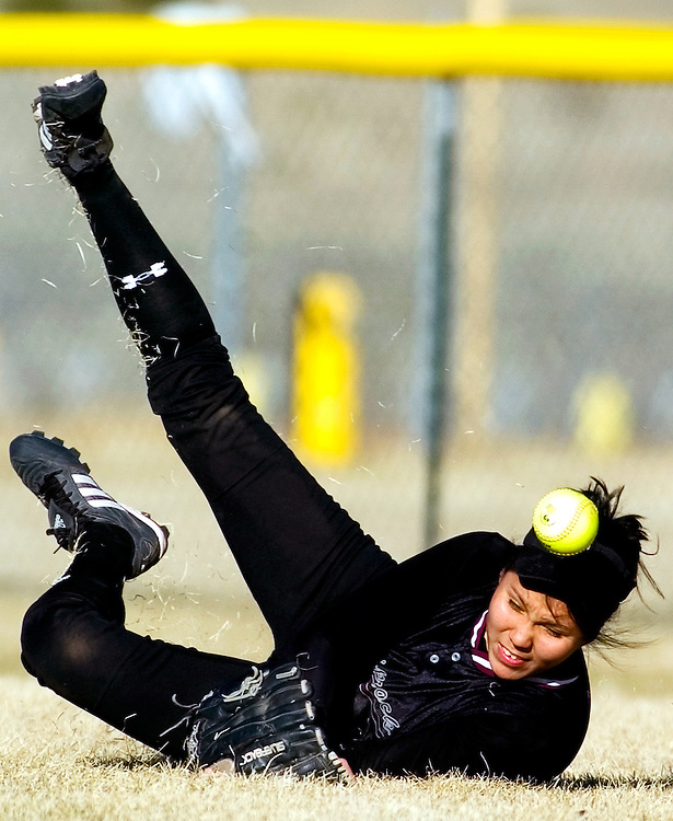 031307     Brian Leddy.Shiprock Lady Chieftan Danella Tutt (10) dives for a fly ball during Tuesday's game against Grants. The Chieftans went on to defeat the Pirates 18-11 on their home turf.