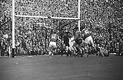 Down keeper set to clear line as Kerry forwards crowd the Down goalmouth near the end of the match but ball is saved during the All Ireland Senior Gaelic Football Final Kerry v Down in Croke Park on the 22nd September 1968. Down 2-12 Kerry 1-13.