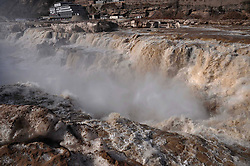 Photo taken on March 7, 2013 shows the scenery of the Hukou Waterfall on the Yellow River in Jixian County, north China s Shanxi Province. As weather warms and more water discharges from the upstream Wanjiazhai Reservoir, the water volume of the Hukou Waterfall greatly increased, March 7, 2013.. Photo by Imago / i-Images...UK ONLY..Contact..Andrew Parsons: 00447545 311662.Stephen Lock: 00447860204379