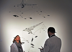 © Licensed to London News Pictures. 11/11/2011. London, UK. A visitor looks at Lynn Chadwick's Mobile 1950, estimated to raise 150,000-250,000 GBP. Sotheby's preview of Modern and Post-War British Art which will offered for sale at auction on 15th November 2011. Photo credit : Stephen Simpson/LNP
