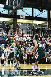 17 December 2011:  John Koschnitzky shoots a leaner over Alan Aboona during an NCAA mens division 3 basketball game between the Washington University Bears and the Illinois Wesleyan Titans in Shirk Center, Bloomington IL