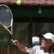 Seiki Tokuhiro, Japan, in action against Camille Dezarnaulds, Australia, in the 75 Mens singles during the 2009 ITF Super-Seniors World Team and Individual Championships at Perth, Western Australia, between 2-15th November, 2009.