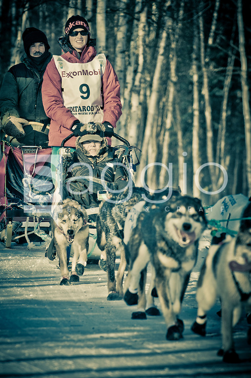 Musher Zoya DeNure and Iditarider John McCaskey ride along the Chester Creek Trail during the 2011 Iditarod Ceremonial Start.
