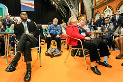 (c) Licensed to London News Pictures. <br /> 03/10/2017<br /> Manchester, UK<br /> <br /> People watch on screens as Foreign Secretary Boris Johnson delivers his speech at the Conservative Party Conference held at the Manchester Central Convention Complex.<br /> <br /> Photo Credit: Ian Forsyth/LNP