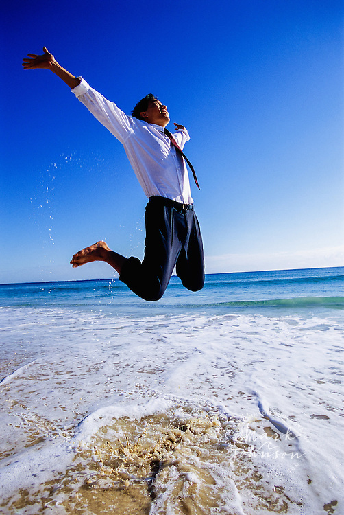 Barefoot Businessman Jumping at the Beach
