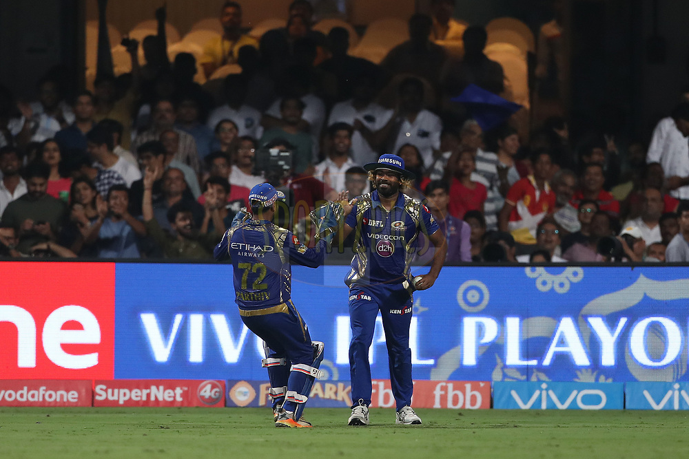 Lasith Malinga of the Mumbai Indians celebrates the wicket of Suryakumar Yadav of the Kolkata Knight Riders during the 2nd qualifier match of the Vivo 2017 Indian Premier League between the Mumbai Indians and the Kolkata Knight Riders held at the M.Chinnaswamy Stadium in Bangalore, India on the 19th May 2017<br /> <br /> Photo by Ron Gaunt - Sportzpics - IPL