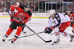 Feb 27, 2014; Newark, NJ, USA; New Jersey Devils right wing Jaromir Jagr (68) skates with the puck while being defended by Columbus Blue Jackets center Artem Anisimov (42) during the first period at Prudential Center.