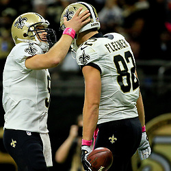 Oct 16, 2016; New Orleans, LA, USA; New Orleans Saints quarterback Drew Brees (9) celebrates with tight end Coby Fleener (82) after a touchdown during the third quarter of a game at the Mercedes-Benz Superdome. The Saints defeated the Panthers 41-38. Mandatory Credit: Derick E. Hingle-USA TODAY Sports