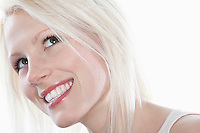 Studio shot of young woman smiling close-up