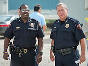 Assistant Chief Michael Benford and Chief Robert Mock attend a groundbreaking ceremony for the new High School for Law and Justice, October 6, 2016.