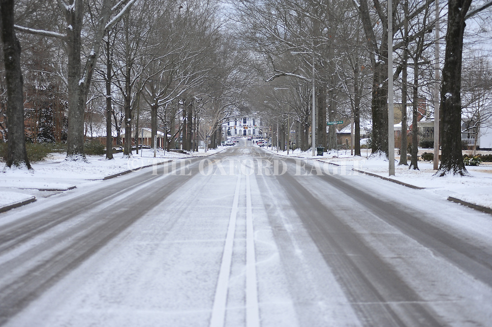 North Lamar Boulevard is coated in ice, in Oxford, Miss. on Tuesday, February 11, 2014. A thin layer of ice covered by snow has closed area schools. (AP Photo/Oxford Eagle, Bruce Newman)