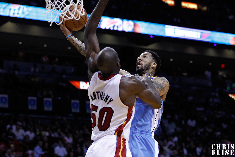 19 March 2011: Denver Nuggets small forward Wilson Chandler (21) goes for the layup against Miami Heat center Joel Anthony (50) during the Miami Heat 103-98 victory over the Denver Nuggets at the AmericanAirlines Arena, Miami, Florida, USA.