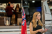 Hostesses and visitors on the Princess Stand - The London Boat Show opens at the Excel centre. London 06 Jan 2017