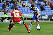 Reading's Lucas Piazon gets past Charlton Athletic defender Zakarya Bergdich during the Sky Bet Championship match between Reading and Charlton Athletic at the Madejski Stadium, Reading, England on 17 October 2015. Photo by Mark Davies.
