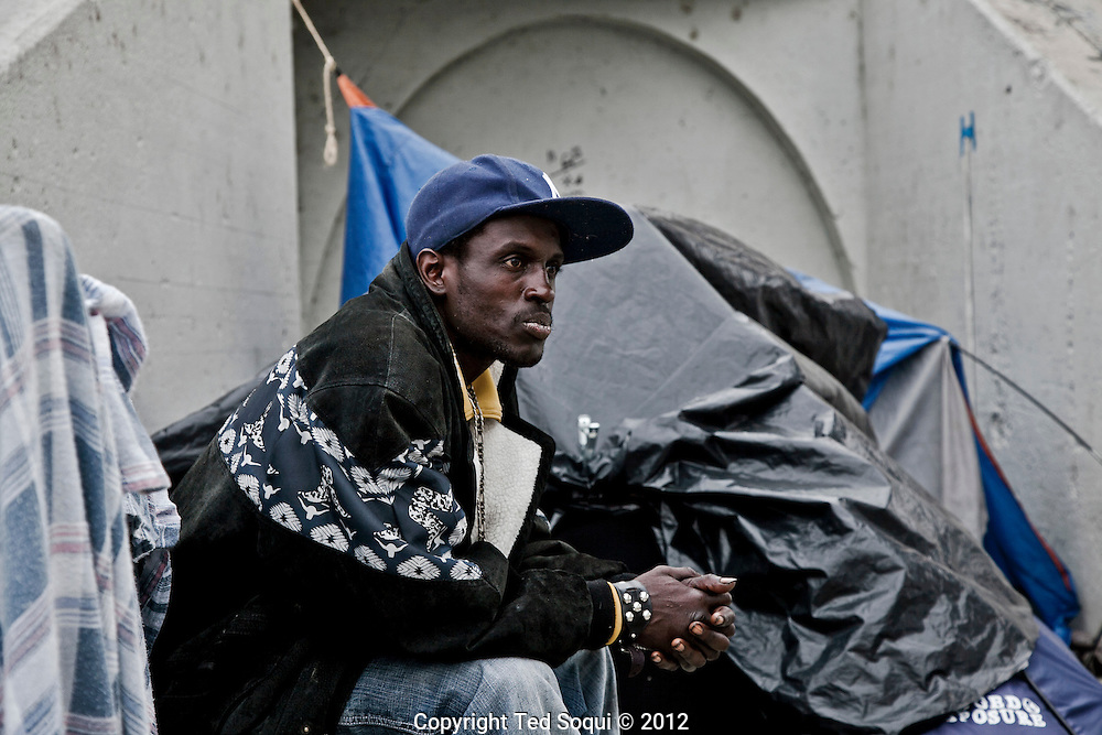 A homeless man living next to the L.A. in downtown L.A.